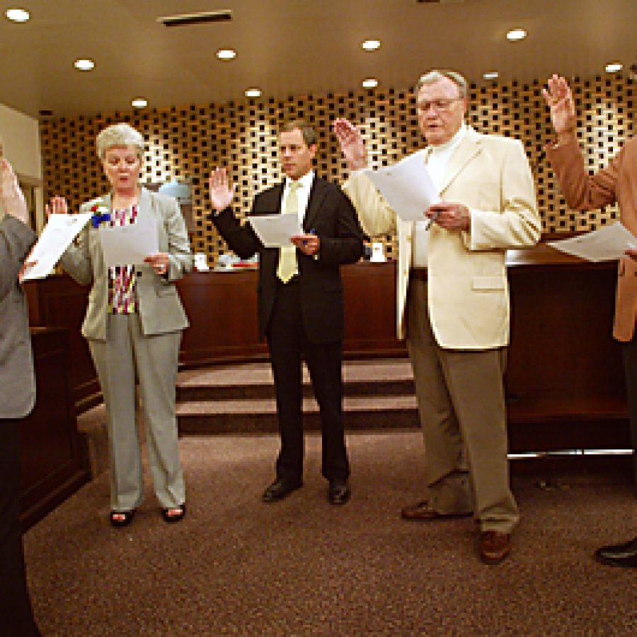 Crestwood City Clerk Tina Flowers administers the oath of office to four aldermen who were re-elected in the April 6 election. Pictured, from left, are: Flowers, Ward 1 Alderman Mimi Duncan, Ward 2 Alderman Jeff Schlink, Ward 3 Alderman John Foote and Ward 4 Alderman Jerry Miguel. At the April 27 board meeting, aldermen were presented with an overview of city finances for the first quarter of 2010. Bill Milligan photo