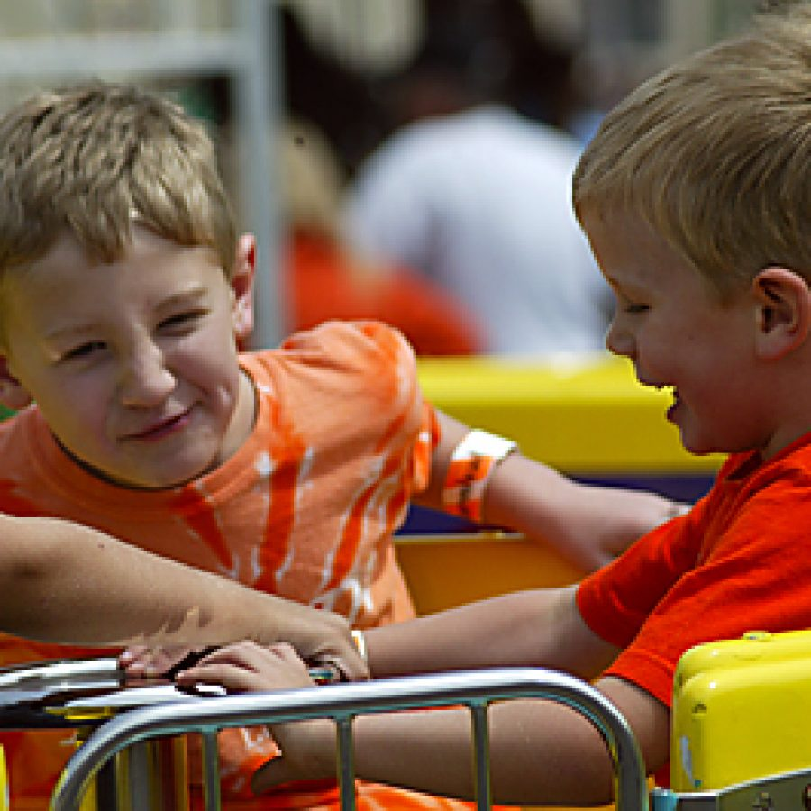 The looks on their faces explain why Quinn, left, and Kyle Sunderland, both 3, of Fenton, enjoy one of the carnival rides at the 2010 Lindbergh Spirit Festival. The 2011 festival will take place Saturday, May 21, and will mark the event's 20th anniversary. William Cooke photo