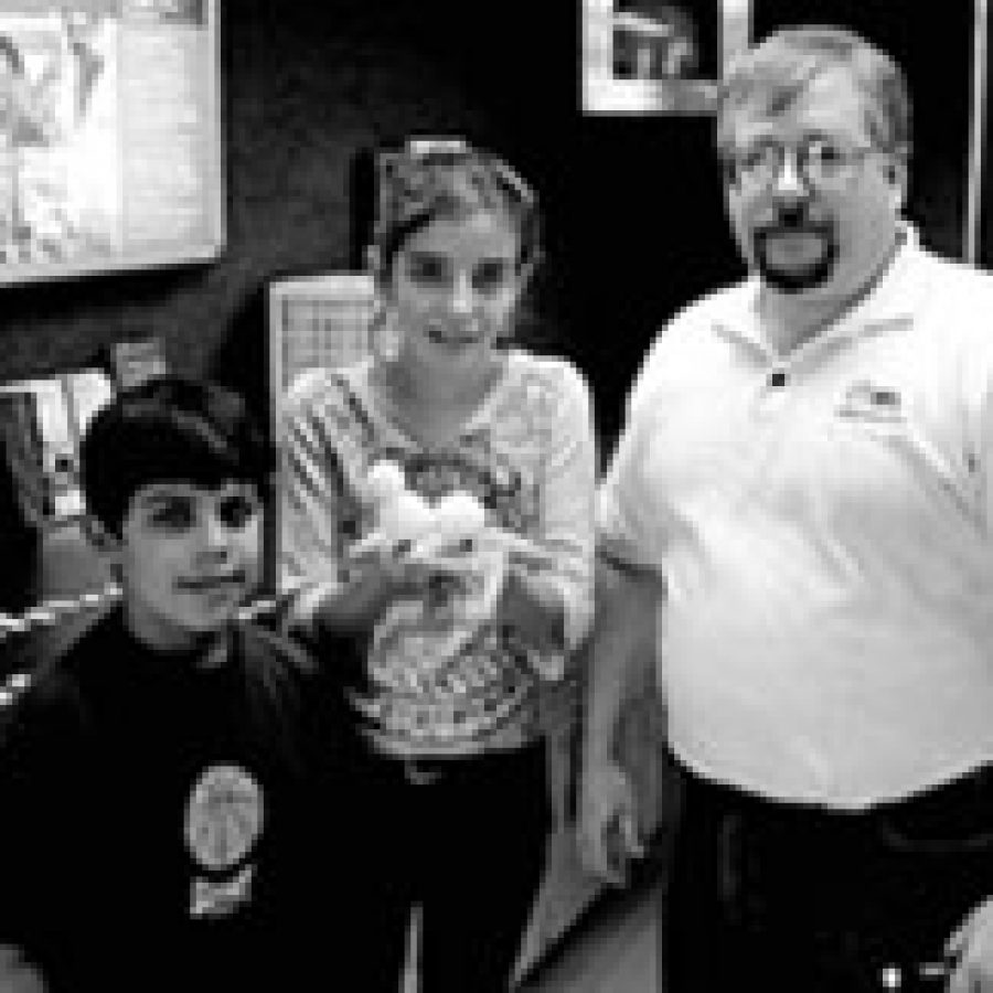 Diego Chavez and Amela Hadzic were among the Buerkle Middle School sixth-graders participating in learning activities in the St. Louis Community College Mobile Tech Center with Richard Norris, senior project associate for biotechnology with the community college.
