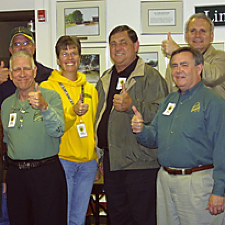 Celebrating the passage of Lindbergh's Prop L on Nov. 2, from left, are: Assistant Superintendent Rick Francis, Assistant Superintendent Nancy Rathjen, board President Ken Fey, board member Don Bee, Yes on Prop L Co-chair Leslie Weiss, board member Larry McIntosh, Chief Financial Officer Pat Lanane, Superintendent Jim Simpson and board Vice President Vic Lenz. Bill Milligan photo