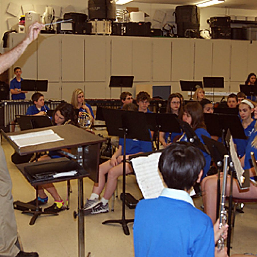 Composer Frank Ticheli rehearses with Mehlville band students during a recent visit.