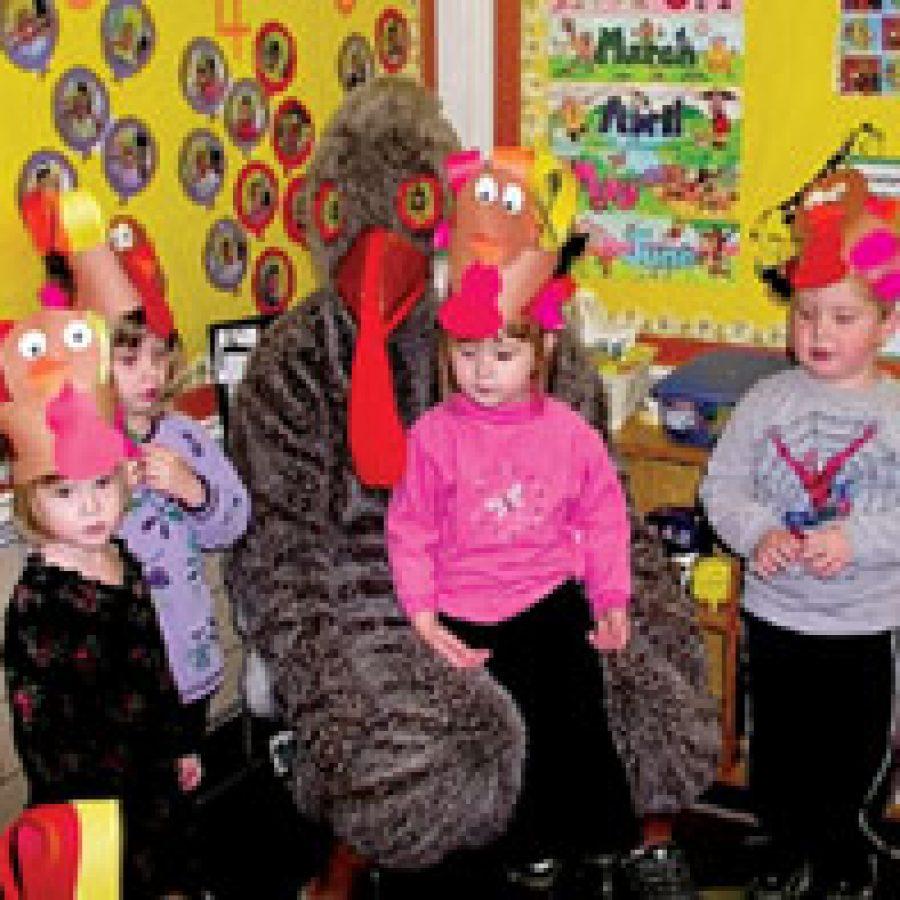 Preschoolers visit with 'Tom Turkey'