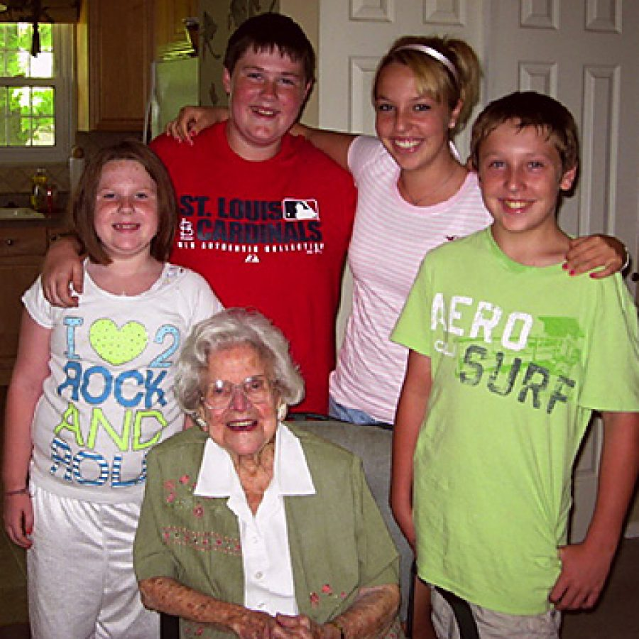 Verna Cole, who celebrated her 100th birthday Saturday, is shown with four of her 10 great-grandchildren. Standing, from left, are: Sammi Stolle, Alex Stolle, Sydney Freukes and Steven Freukes.