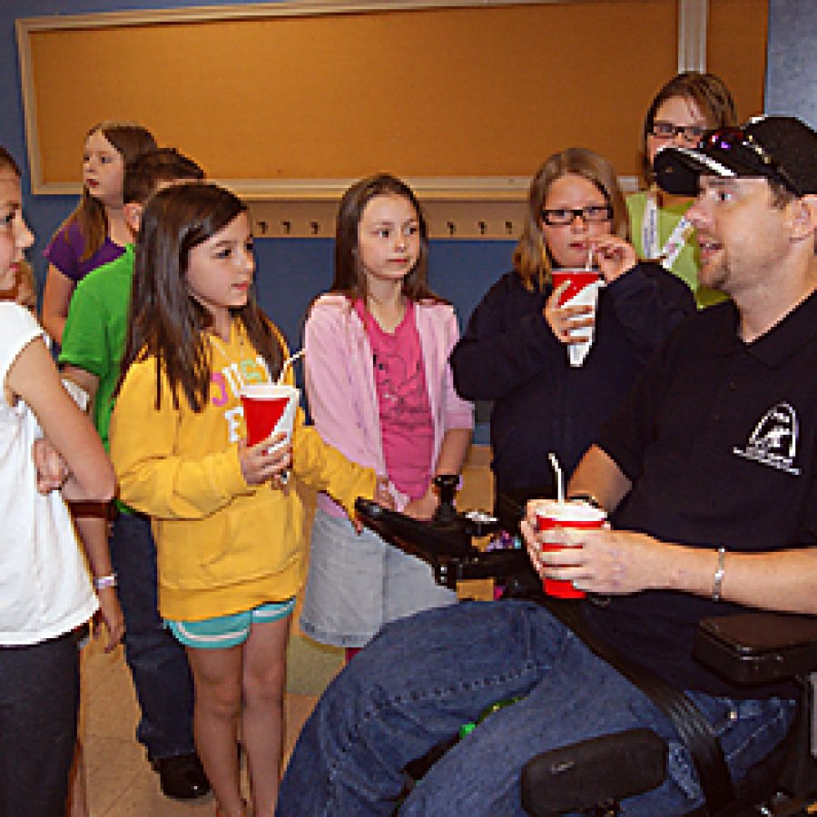 Point Elementary third graders, from left, Lauren Kuehn, Molly Martin, Brooke Sheerin, Allyson Turner and Madelynn Turner visit with a local veteran when the school hosted veterans from the Jefferson Barracks V.A. Medical Center's Spinal Cord Injury Unit and the Paralyzed Veterans of America for a root beer ice cream float social on May 16.