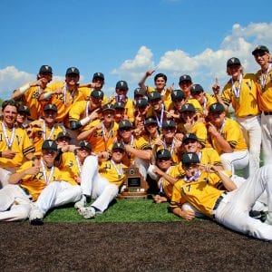 Vianney's varsity baseball team poses with their 2018 state championship trophy.
