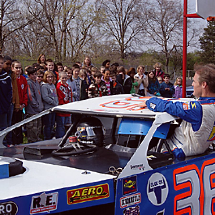 Following his motivational presentation about preparing for the Missouri Assessment Program tests, NASCAR driver and former Beasley Elementary first grader Kenny Wallace gave Beasley students a close-up view of his dirt track racecar during a visit on March 30.